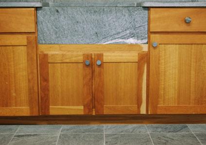 soapstone countertop, sink, and floor tiles