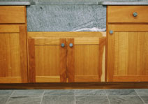 soapstone countertop, sink, and floor tiles