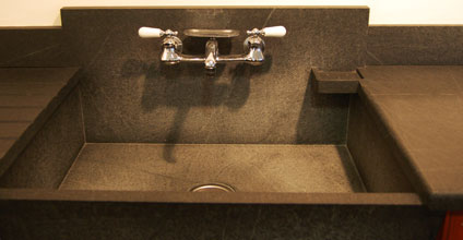 soapstone drainboard and sink with soap dish